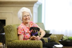 Photo: The Gardens at Town Square senior living female resident with her dog - Era Living